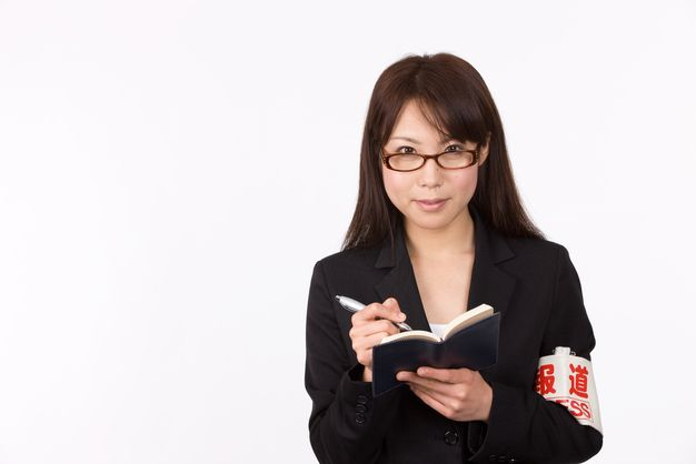 記者の女性